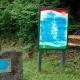Pintarrajean con borrones y un símbolo neonazi la fosa común de Cabacheros (Asturias)